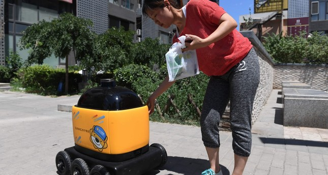 In China, yellow robots deliver snacks to houses