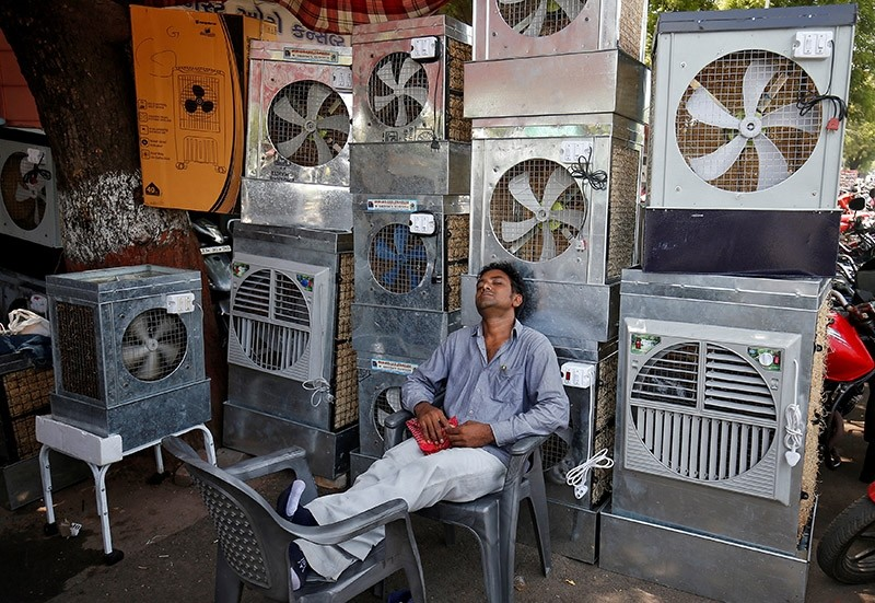 A man selling air coolers rests at a market on a hot summer day in Ahmedabad, India May 4, 2017 (Reuters Photo)