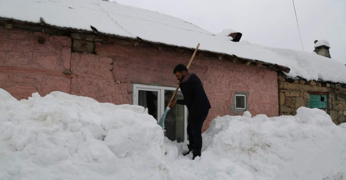 A man clearing the snow outside a house in the district of Ovacu0131k, Tunceli, Feb. 7, 2020. (IHA Photo)