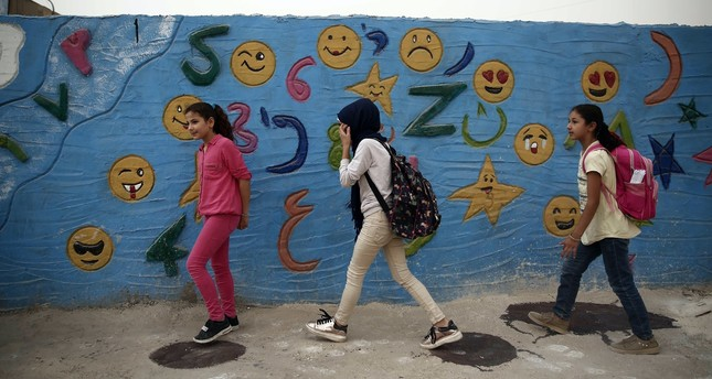 Syrian children walk to school in the northern city of Azaz, near the border with Turkey, Oct. 16, 2018.