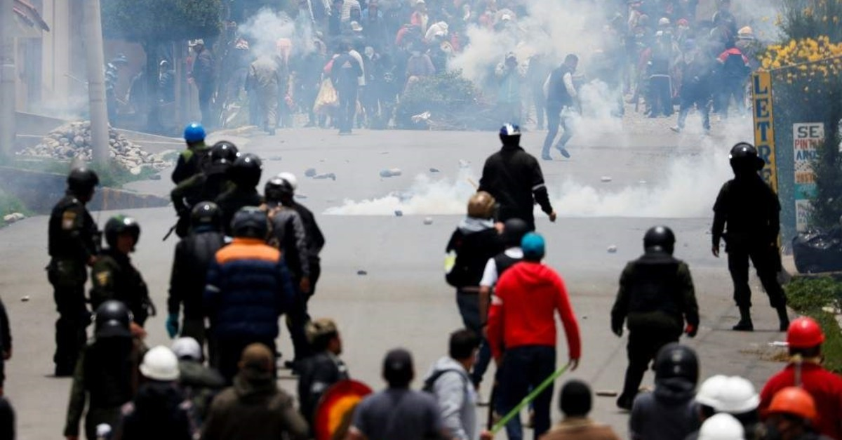 Supporters of Bolivian President Evo Morales and opposition supporters clash during a protest on Sunday, in La Paz Bolivia November 11, 2019. (REUTERS Photo)