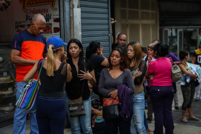 Relatives of victims of the stampede in the Social Club El Paraiso react in front of the headquarters of the Scientific Police (Cicpc), in Caracas, Venezuela, 16 June 2018.  (EPA Photo)