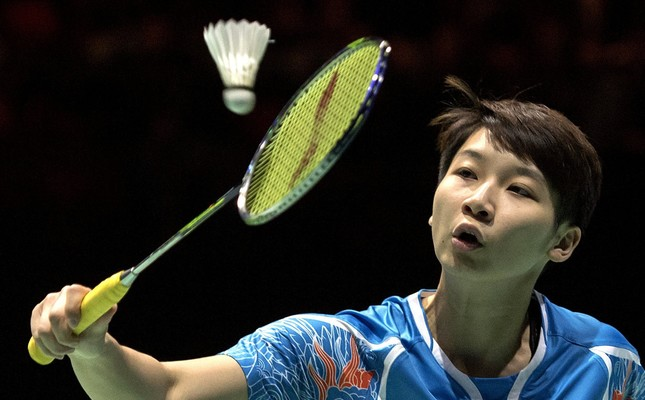 China's Chen Xiaoxin returns a shuttlecock to China's Chen Yufei during their women's singles final match at the Badminton Swiss Open tournament in the St. Jakobshalle in Basel, Switzerland.