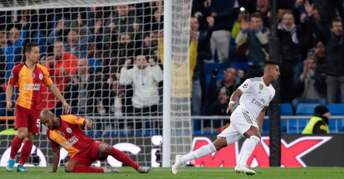 Real Madrid's Rodrygo, right, reacts after scoring the opening goal during a Champions League group A soccer match between Real Madrid and Galatasaray at the Santiago Bernabeu stadium in Madrid, Spain, Wednesday, Nov. 6, 2019. (AP Photo)
