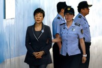 In this Aug. 7, 2017, file photo, former South Korean President Park Geun-hye, left, arrives for her trial at the Seoul Central District Court in Seoul. (AP Photo)