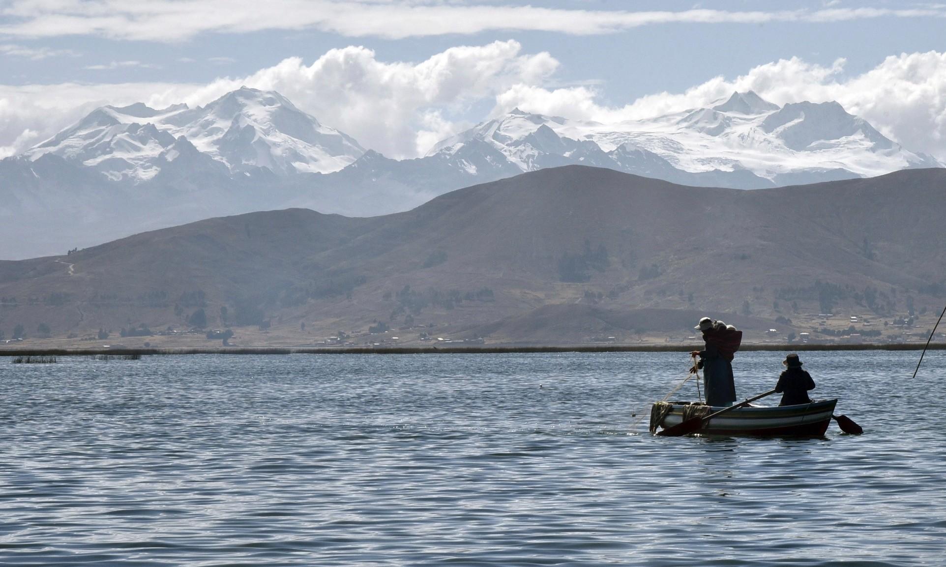 Aymara indigenous people fish on Lake Titicaca near Quehuaya in Bolivia.
