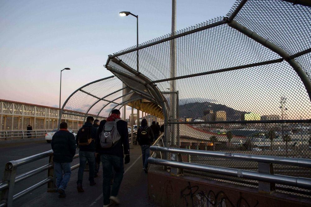 People walk to the United States at El Paso del Norte International Bridge on the U.S.-Mexico border in Ciudad Juarez, on Feb. 20.