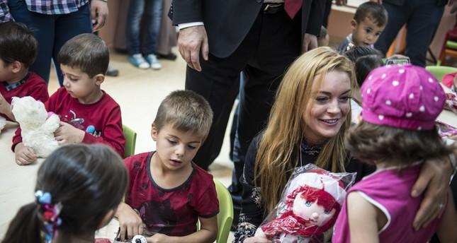 Lindsay Lohan met Syrian children in a refugee camp during her visit to Turkey.