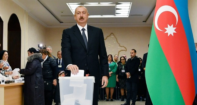 Azerbaijan President Ilham Aliyev casts his ballot at a polling station during parliamentary elections in Baku, Azerbaijan, Sunday, Feb. 9, 2020. Azerbaijan Presidential Press Office via AP