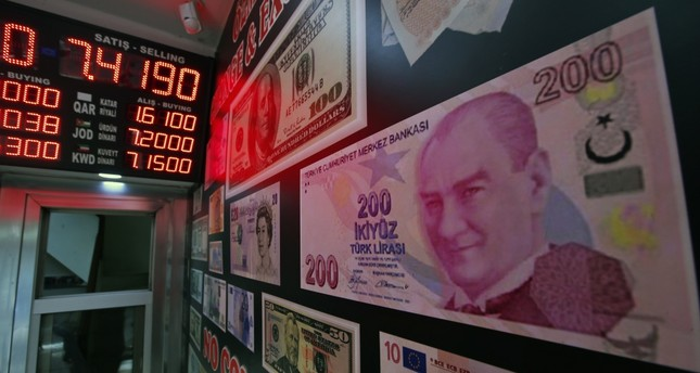 An oversized copy of a 200 Turkish lira banknote decorates a currency exchange shop in Istanbul.
