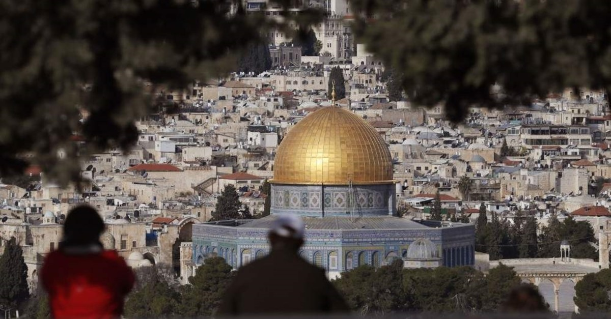 Tourists looking at the panoramic view of Old Jerusalem with the Dome of the Rock seen in the foreground, the Mount of the Olives, Jan. 27, 2020. (AFP)