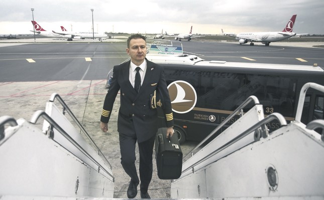 Pilot Sertaç Seymen, who has been a pilot for the last 27 years, arrives at the airport two hours prior to his flight for security checks.