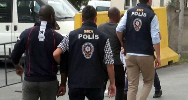 Istanbul police escort Nigerian suspects in another operation against a fraud gang in this 2018 photo. PHOTO BY EM?R SOMER