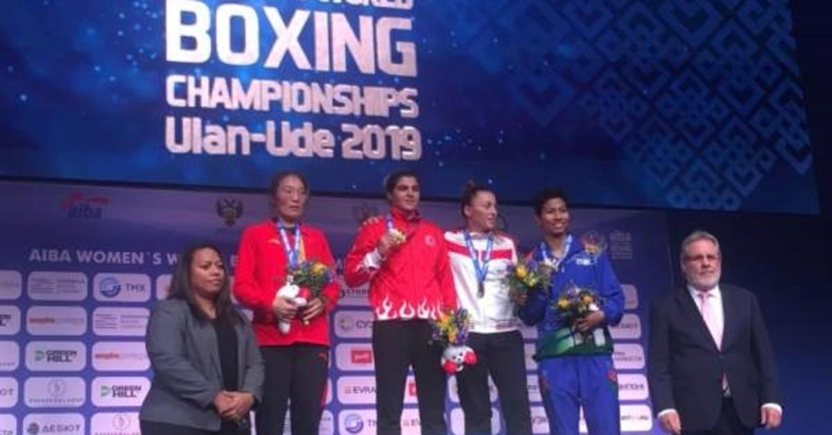 Busenaz Su00fcrmeneli (C) defeated Liu Yang to win gold, Ulan Ude, Oct. 13, 2019. (AA Photo)