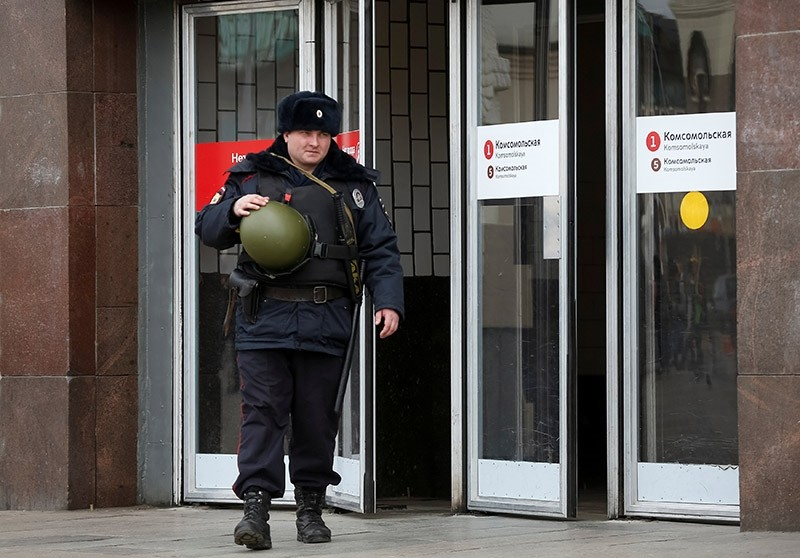 A police officer walks in front of a metro station following the St. Petersburg metro blast that took place on April 3 (Reuters Photo)