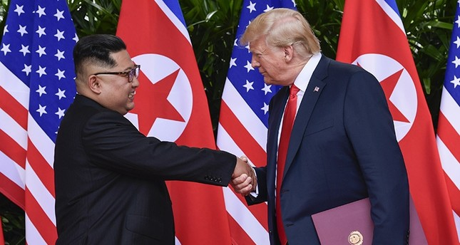 North Korea leader Kim Jong Un and U.S. President Donald Trump shake hands at the conclusion of their meetings at the Capella resort on Sentosa Island Tuesday, June 12, 2018 in Singapore. (AP Photo)