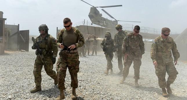 U.S. soldiers walk as a NATO helicopter flies overhead, Nangarhar, Aug. 13, 2015.