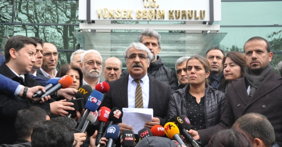 HDP Mardin deputy Mithat Sancar holds a press conference in front of the Supreme Election Council (YSK) headquarters in Ankara, April 11, 2019. (DHA Photo)