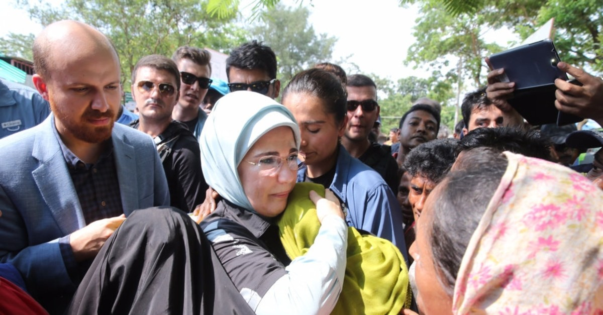 Emine Erdou011fan hugs a refugee woman during a visit to a refugee camp for Rohingya Muslims in Cox's Bazaar, Bangladesh in 2017. The first lady was hailed for leading humanitarian efforts for the displaced community.