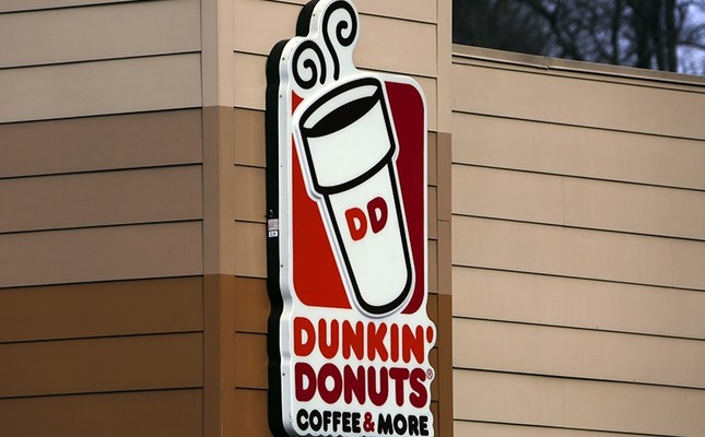 This Jan. 22, 2018, file photo shows a Dunkin' Donuts sign on a shop in Mount Lebanon, Pa. (AP Photo)