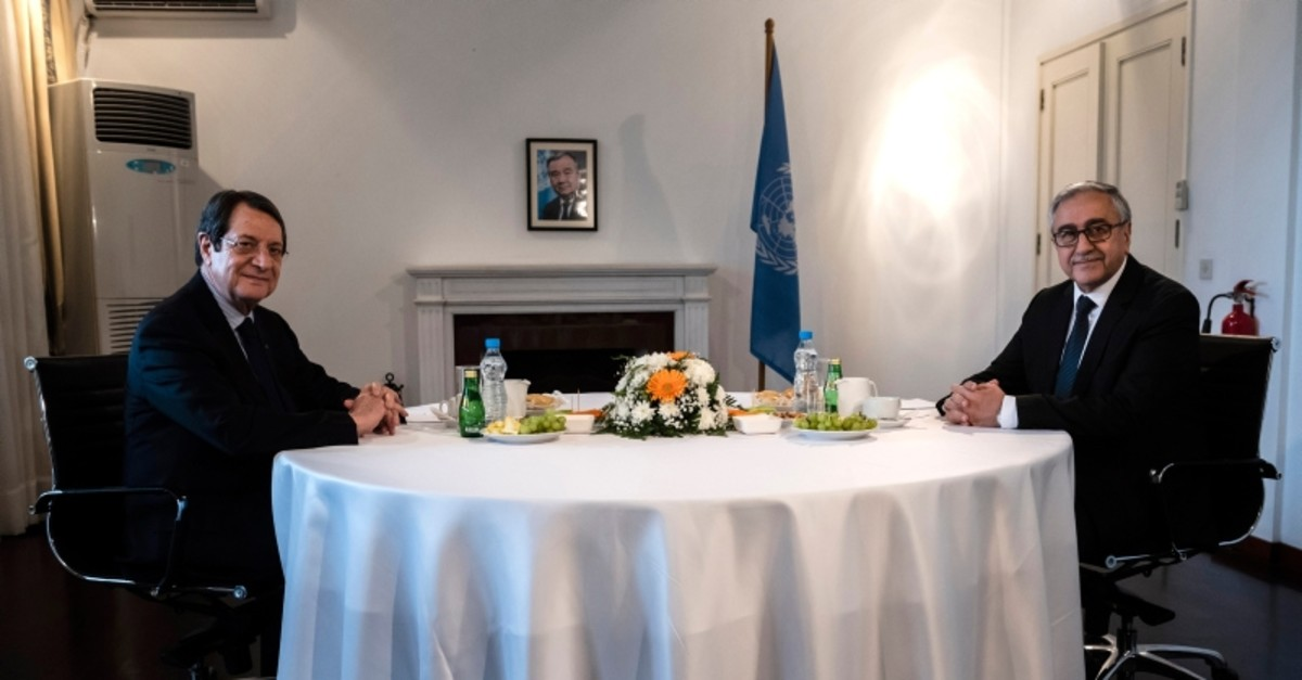 Turkish Cypriot leader Mustafa Aku0131ncu0131, right, and Greek Cypriot leader Nicos Anastasiades pose for a photo during their meeting at a U.N compound inside the U.N buffer zone in divided capital Nicosia, Cyprus, Tuesday, Feb. 26, 2019. (AP Photo)