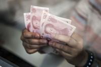 تراجع اليوان الصيني أمام الدولار الأمريكي يؤثر سلبا على أسعار الأسهم الصينية
