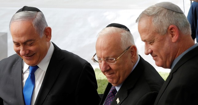 Israeli PM Benjamin Netanyahu L, President Reuven Rivlin and Benny Gantz, leader of Blue and White party, stand next to each other at a memorial ceremony for late President Shimon Peres, at Mount Herzl in Jerusalem, Sep. 19, 2019. Reuters Photo