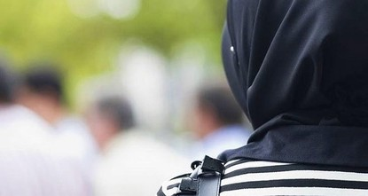 pA woman in the U.K. is suing the estate agents where she formerly worked over remarks telling her to take off her black headscarf because of its terrorist affiliations./p  pThe woman was working...