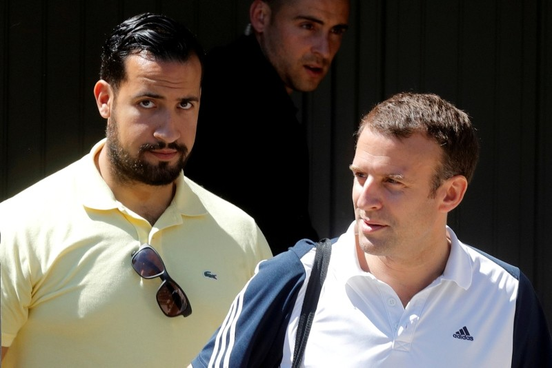 French President Emmanuel Macron, flanked by Alexandre Benalla, French presidential aide, leaves his home to play tennis in Le Touquet, France, June 17, 2017. Picture taken June 17, 2017. (Reuters Photo)