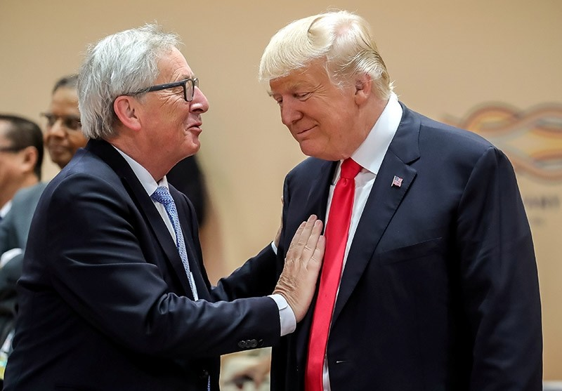 U.S. President Donald Trump (R) talks with European Commission President Jean-Claude Juncker prior to a working session at the G-20 summit in Hamburg, Germany, July 8, 2017. (Reuters Photo)