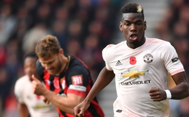 Manchester United's Pogba (L) will play against his idol Juventus star Ronaldo today.