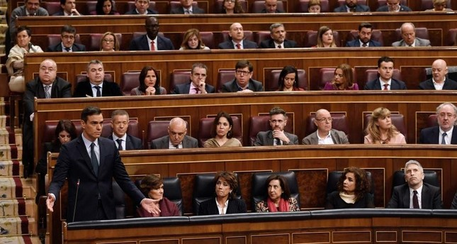 Spanish caretaker Prime Minister Pedro Sanchez speaks from his seat during the second day of a parliamentary investiture debate to vote for a premier at the Spanish Congress in Madrid on Jan. 5, 2020. AFP Photo