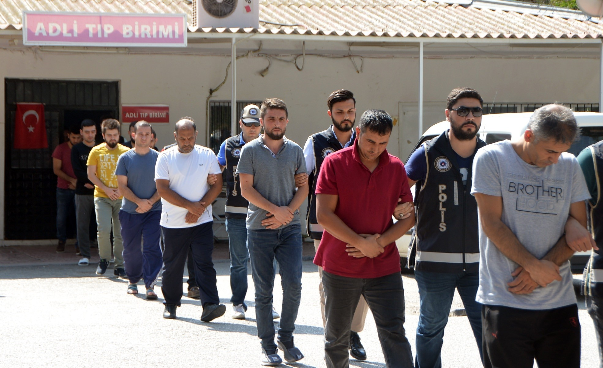 Police escort FETu00d6 suspects including former and active soldiers after they were detained in the southern province of Adana, Sept. 22.