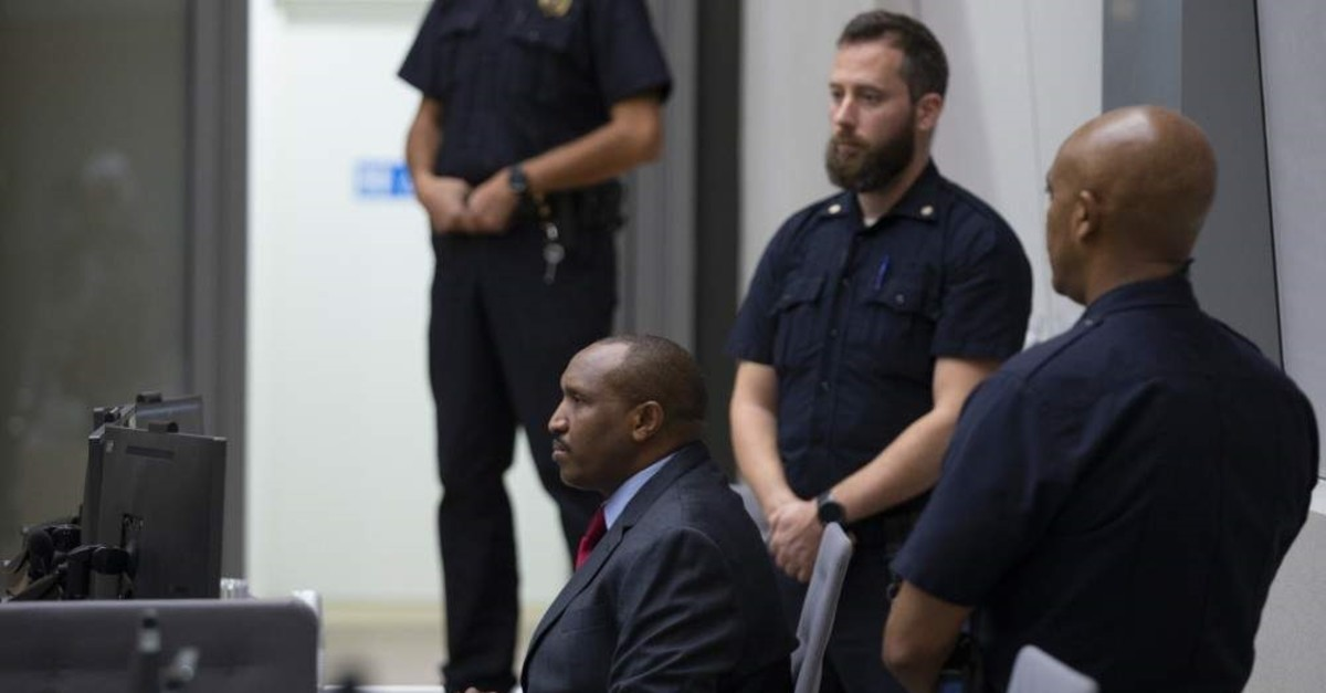 Congolese militia commander Bosco Ntaganda takes his seat in the courtroom of the International Criminal Court, or ICC, to hear the sentence in his trial in The Hague, Netherlands, Thursday, Nov. 7, 2019. (AP Photo)
