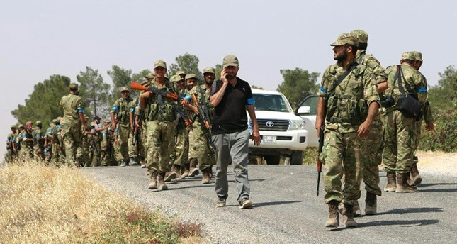 Turkmen fighters of Sultan Murat Brigade seen advancing to Keklijah village some five kilometers west of northern Syrian town of Jarablus. (AA Photo)