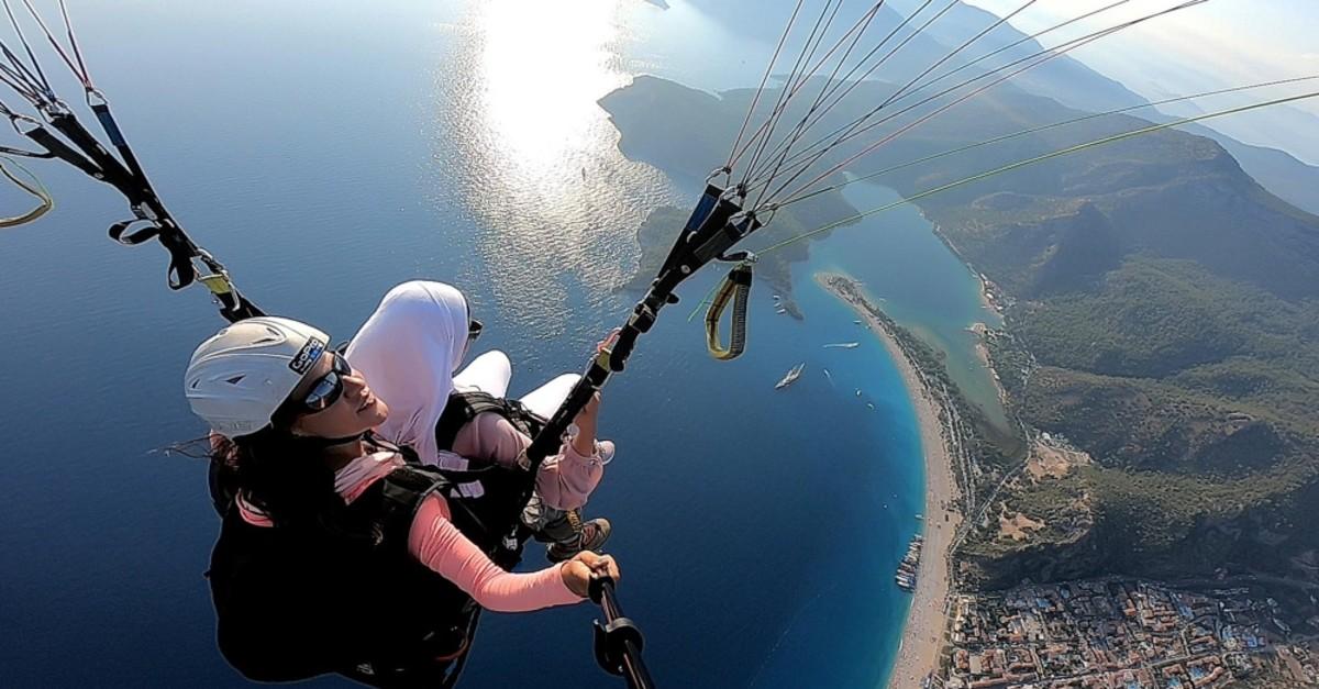 A paragliding instructor films a trip down from Mt. Babadau011f.