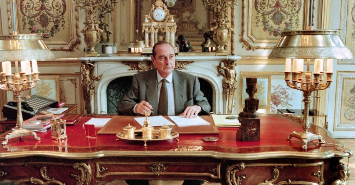 French President Jacques Chirac poses in his office at the Elysee palace in Paris, April 27, 1996.