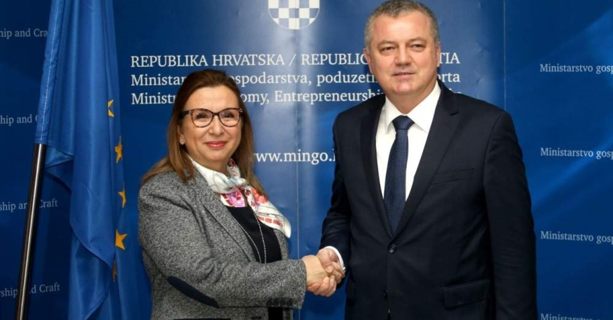 Trade Minister Ruhsar Pekcan (L) shakes hands with Darko Horvat, Croatia's economy, entrepreneurship, and crafts minister, Zagreb, Croatia, Feb. 11, 2020. (AA Photo)
