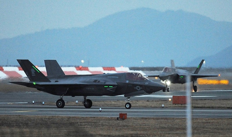 This picture taken on January 18, 2017 shows two US F-35B stealth fighter jet taxiing after landing at the US Marine's Iwakuni Air Station in Iwakuni, Yamaguchi prefecture. (AFP Photo)
