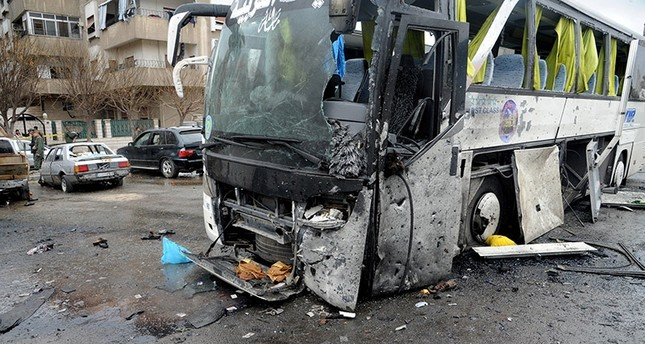 A handout photo made available by the Syrian Arab News Agency (SANA) shows a damaged bus at the site of bombing, in Damascus, Syria on March 11, 2017. (EPA Photo)