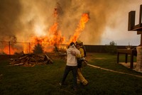 Firefighters battle destructive blazes near homes in California