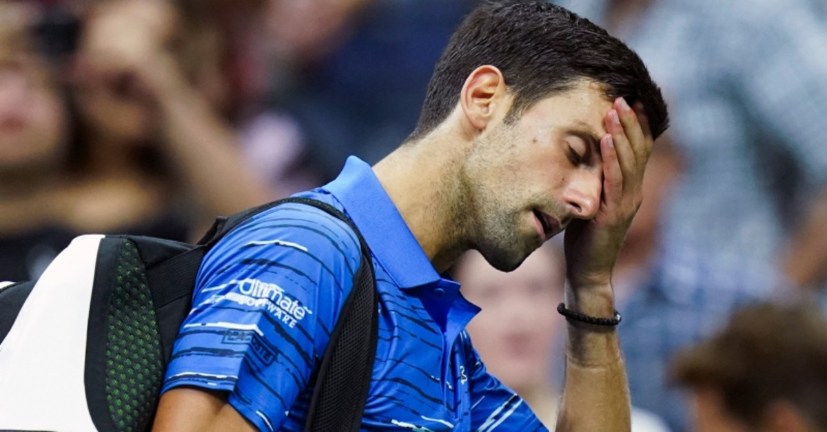 Novak Djokovic, of Serbia, walks off the court as he retires during his match against Stan Wawrinka, of Switzerland, during the fourth round of the U.S. Open tennis championships, Sunday, Sept. 1, 2019, in New York. (AP Photo)