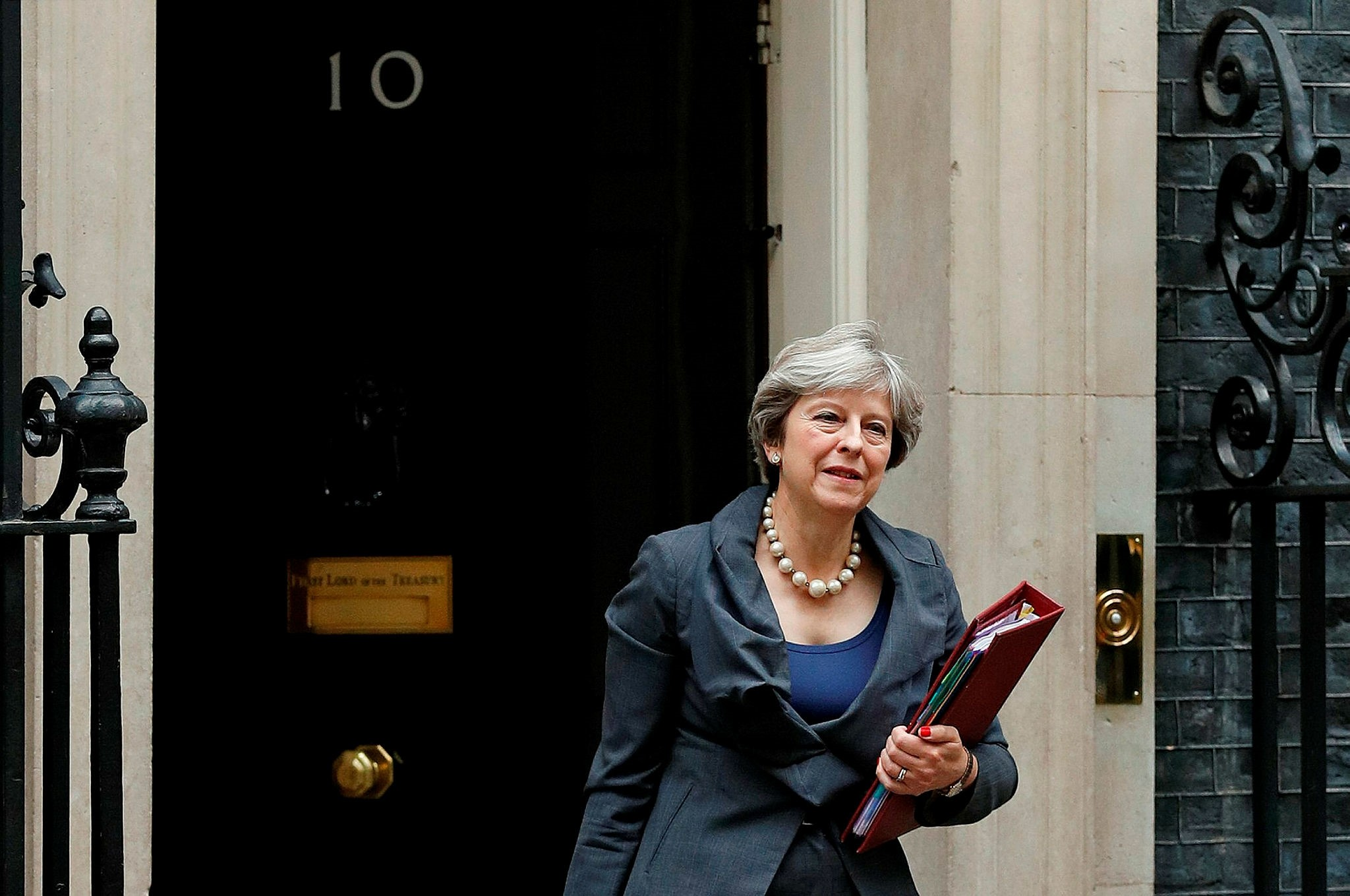 Britain's Prime Minister Theresa May leaves 10 Downing Street in central London on October 11, 2017, on her way to the Houses of Parliament to speak at Prime Minister's Questions (PMQs). (AFP Photo)