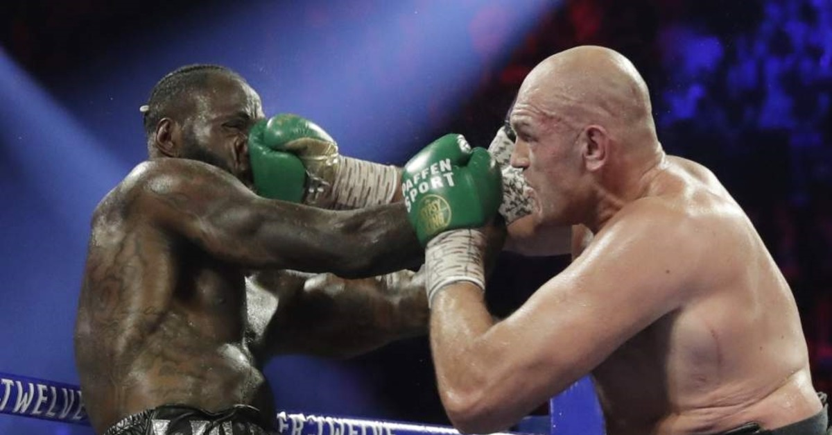 Fury lands a right to Wilder during a WBC heavyweight championship boxing match in Las Vegas, Feb. 22, 2020. (AP Photo)