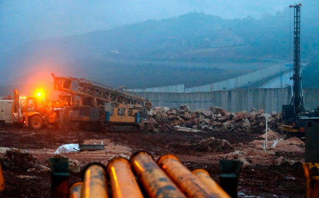 This file photo taken on Dec. 19, 2018 shows a view of Israeli excavation equipment at work near the concrete barrier along the border with Lebanon, near the northern Israeli town of Metula. (AFP Photo)