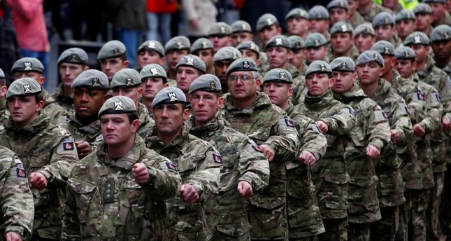 Soldiers of the British Army's Royal Scots Dragoon Guards regiment march down the Royal Mile to mark their return from a tour of duty in Helmand Province in Afghanistan, during a Homecoming parade in Edinburgh, Scotland, Dec. 1, 2011. (Reuters Photo)