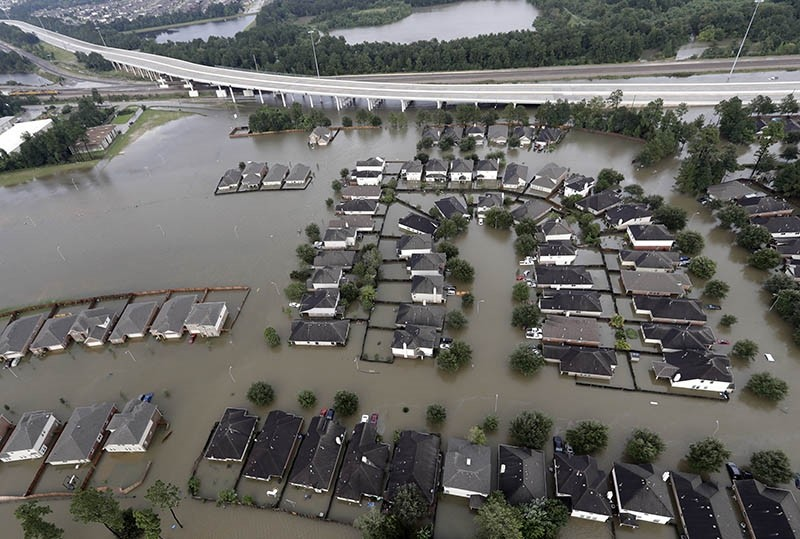 Homes are surrounded by floodwaters from Tropical Storm Harvey in Spring, Texas, U.S., Aug. 29, 2017. (AP Photo)