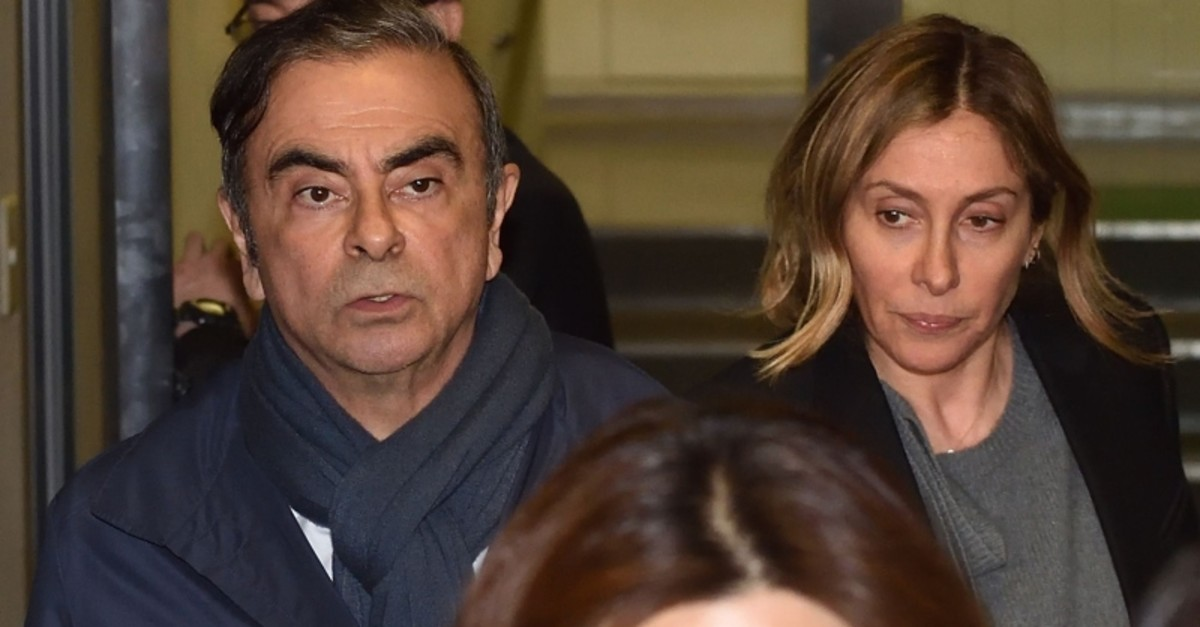 Former Nissan Chairman Carlos Ghosn (L) and his wife Carole (R) leave the office of his lawyer Junichiro Hironaka in Tokyo on April 3, 2019. (AFP Photo)