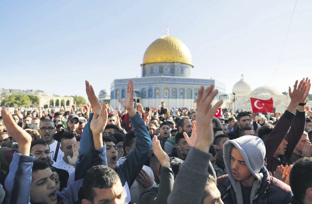 Palestinian worshippers shout slogans after Friday prayers at the Al-Aqsa Mosque compound in Jerusalem's Old City, on Dec. 8.