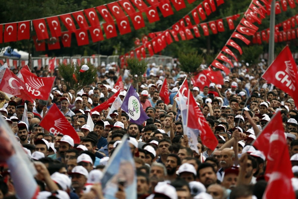 HDP and CHP flags wave side by side during a rally of CHP's presidential candidate Muharrem u0130nce in the southeastern province of Diyarbaku0131r, June 13, 2018.